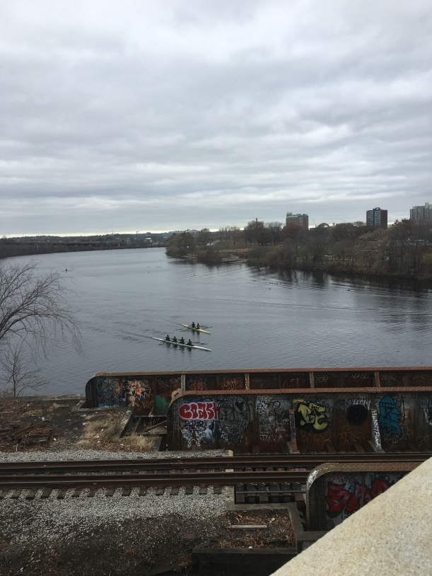 Two crew rowing on the Charles River from the Boston University Bridge