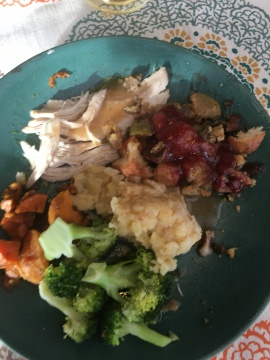 Thanksgiving plate - turkey with gravy, broccoli, sweet potatoes, and stuffing